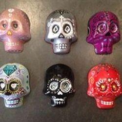 Plaster hanging skulls
