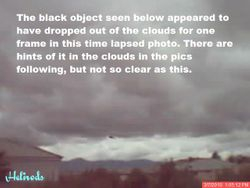 Black object drops out of rain clouds