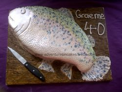 Fish (trout) shaped birthday cake. The knife is also edible