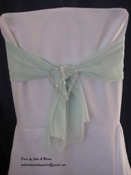 Aqua voile with pearl heart.
