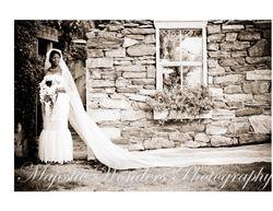 Bride posing alone