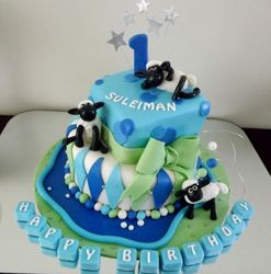 Shaun the sheep tiered cake