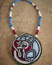 Beaded rat medallion