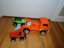 Tow Truck with 2 Off-Road Trucks - $5
