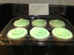 Green Appletini cupcakes-vanilla cupcakes filled with apples and frosted with green apple flavored buttercream