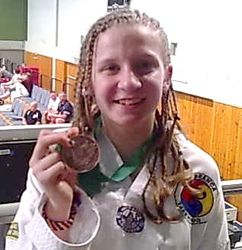 Madelyn with her Bronze Medal