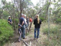 Community Bus Trip - CMN Ranger explaining the grazing exclosure plots