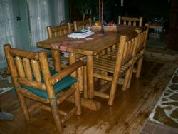 hand made rustic log dining table with chairs