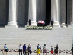 View of Casket Guarded by Clerks and Crowd of Mourners at West Façade of US Supreme Court Building from Southwest During Lying in Repose of Associate Supreme Court Justice Ruth Bader Ginsburg
