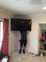 John disappeared behind this giant TV