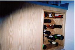 Oak Wine Rack Built into existing cabinets.