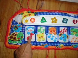 Fisher Price Kick & Play Piano (Crib) - $10