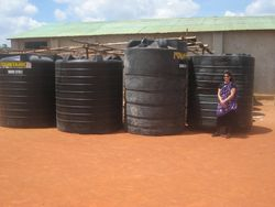 The water storage tanks temporarily stored by a Pommern warehouse operated by the village Roman Catholic church