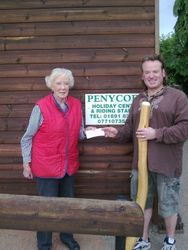 Handing over a cheque after the sponsored Didgeridoo play to the RDA