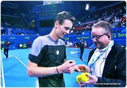 Tomas Berdych signs balls with his autograph