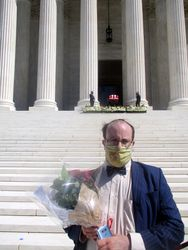 View of Alec Frazier Holding Bouquet of Flowers in Front of Casket Guarded by Clerks at West Façade of US Supreme Court Building from West During Lying in Repose of Associate Supreme Court Justice Ruth Bader Ginsburg