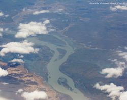 Small cumulus of fair weather and river seen from a jet airplane.