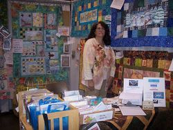 Lu Feazle at Robin Quilt Nest Expo Booth