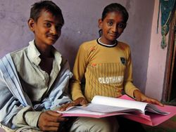 51 Gabbar comes to the Mathura drop-in centre for a couple of hours a day.  Tulsi, 15, is helping him to learn to read and write