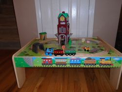 KidKraft Wood Train Table with Track, Thomas Trains, and Clock Tower - $50