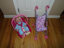 Doll Stroller & Carrier with Doll - $20