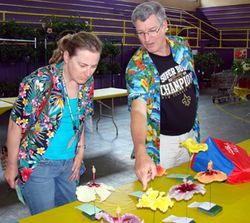 Carolyn McCarroll and Show Director Jim Gedicke entering blooms