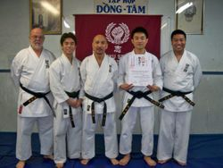 Tan and his black belts.