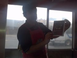 Chef in Queens, NY holding a copy of the Love House.