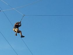Matt Whisenant leaps off  zip line platform 2