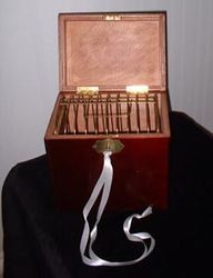 The Mahogany Box and Cage.