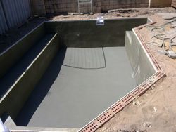 Concrete pool base installed