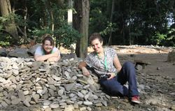 Chloë Wright and Camilla Cenni examining a stone handling artefact (Ubud Monkey Forest, Bali, May 2018)