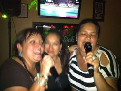 "Irka (left) and Lissette (right) singing some ""Dancing Queen"" for the crowd at Legendary Friday Night Karaoke!"
