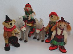 Zirkustruppe mit Eseln