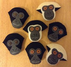 Hand-stitched ornaments of the spider monkeys and gibbons