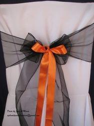 Black bow with orange ribbon.
