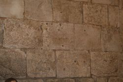 The bullet scarred walls at the Jaffa Gate, Old Jerusalem