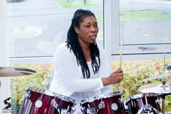 Sandra playing the drums during church service on Sunday