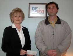 Carol Moss Read accepting a generous donation from  Daniel Jakcson