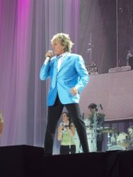 Rod singing in Sky Blue jacket