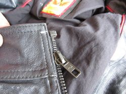 Stick new zip in place