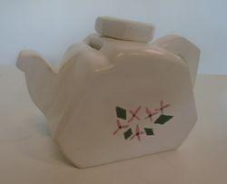 "Tirelire Tea pot: 7"" x 4.5""  $15.00"