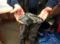 Doug Bowes shows off a piece of arsenic pyrite