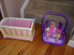Doll Cradle & Carrier with Doll - $13