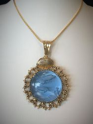 Carved glass dolphin pendant in 14k