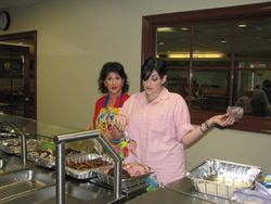 Jill getting lunch ready while Debbie supervises