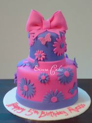 Pink and purple , flowers and butterfly cake