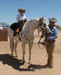Ellissa Bird riding Willow Tango Bandit led by Tabetha Parrish