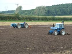 Ford 8200 & Doe tractors at work