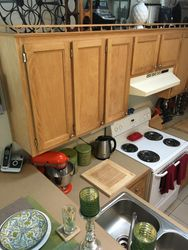 Kitchen cabinets and electric stove